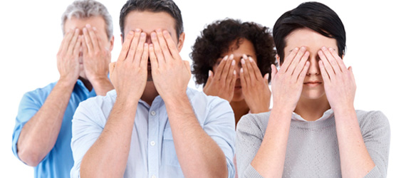 group of business people shielding their eyes