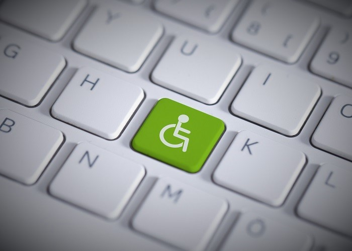 a keyboard with a green handicap key