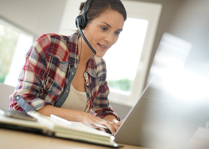 call center agent with headset working from home